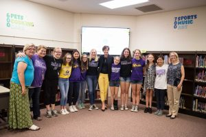 photos of Girls Who Code Club members with Gov. Reynolds